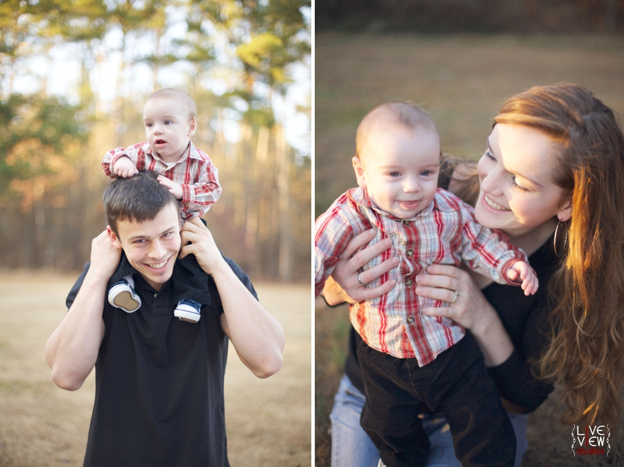 dad holding little boy on shoulders, mother smiles with child