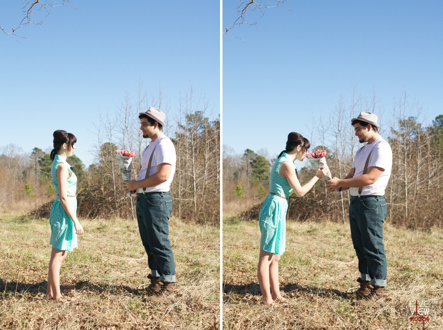 romantic valentine engagement photography, man bringing pretty pink flowers wrapped in newspaper for his girlfriend