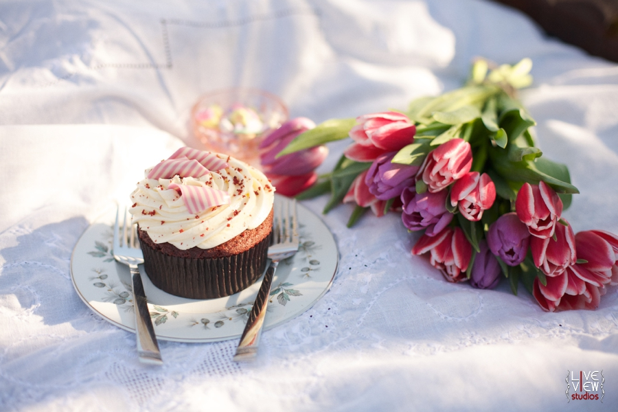 red velvet cupcake topped with creamy icing and peppermint curls, valentine's day picnic inspiration