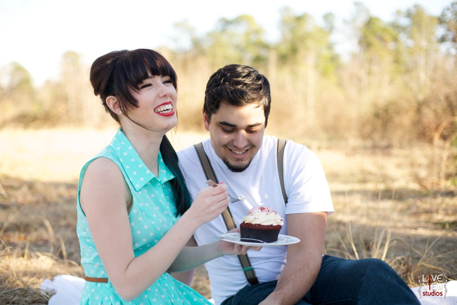 a couple shares a cupcake on a valentine's day picnic, vintage inspired couple's photography