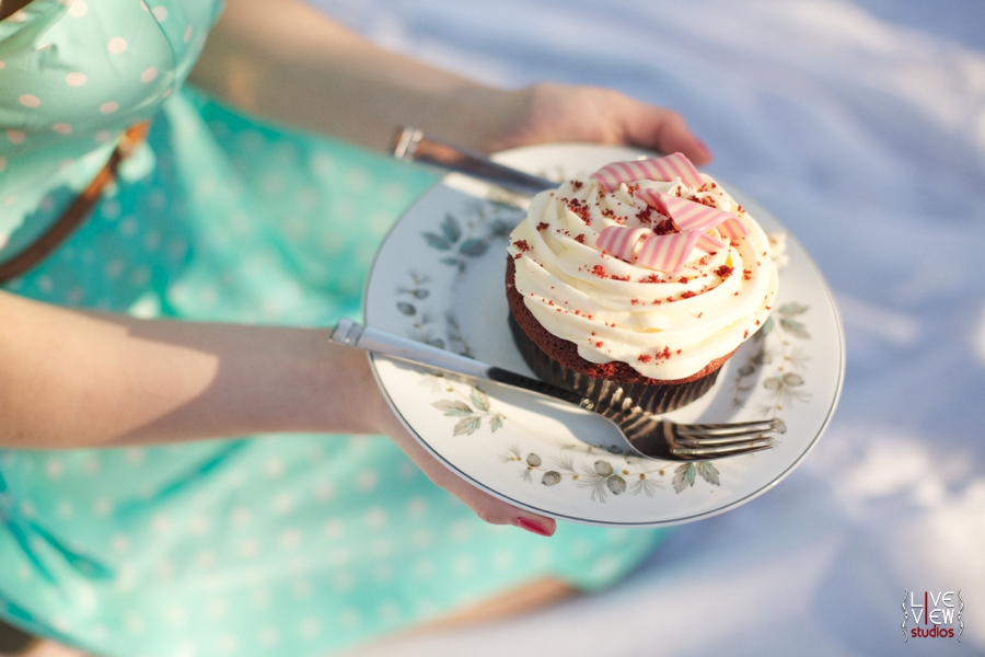 red velvet cupcake covered with creamy icing and striped peppermint slices, raleigh nc food photography