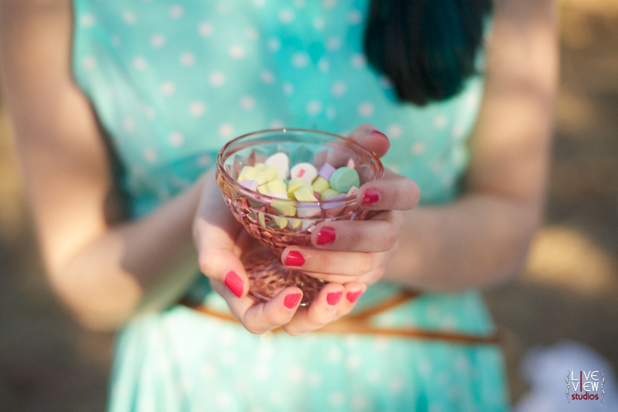woman holding a glass goblet with colorful sweetheart candies, raleigh nc portrait photographers