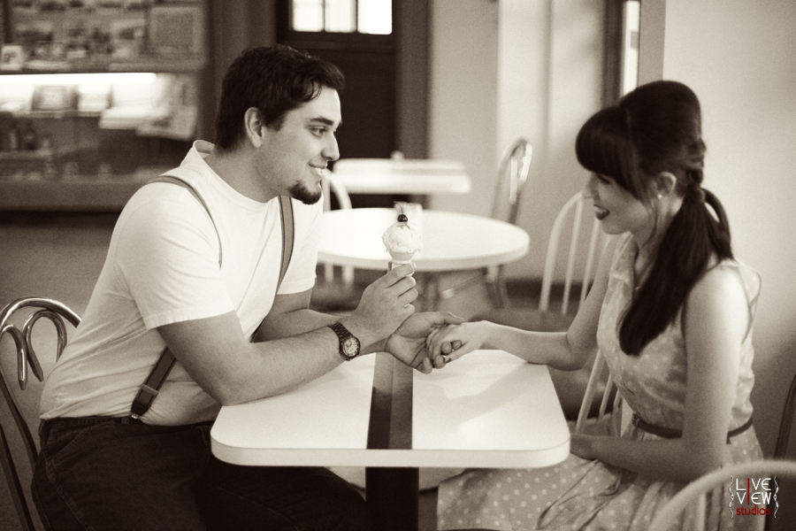 young sweethearts share an ice cream cone in elliotts pharmacy in north carolina, retro couple's photography