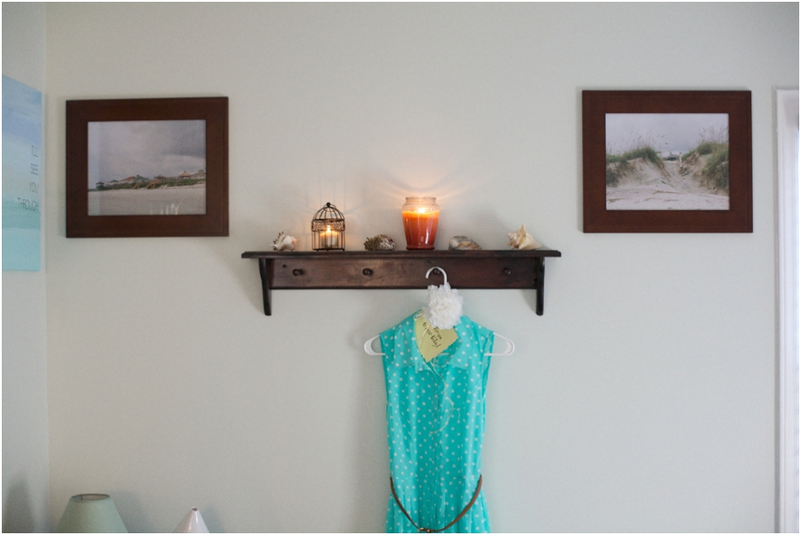 beautiful beach film photography hung on the wall of beach-cottage-themed bedroom makeover