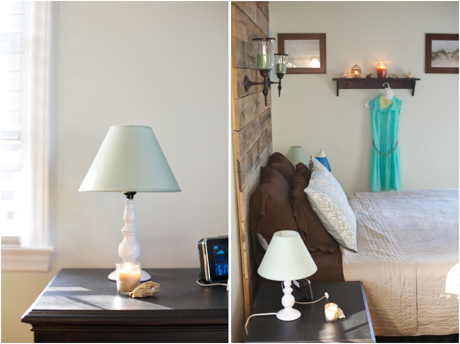 whitened sage wall color paired with dark wood furniture and accented with whites, light blues, and browns