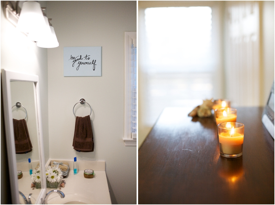whitened sage wall color contrasted dark brown hand towel, candles lit on chester drawers, bright interior decoration ideas