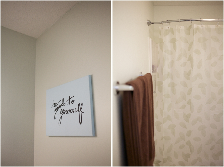 wall sign for home, brown terry towels hanging in remolded bathroom