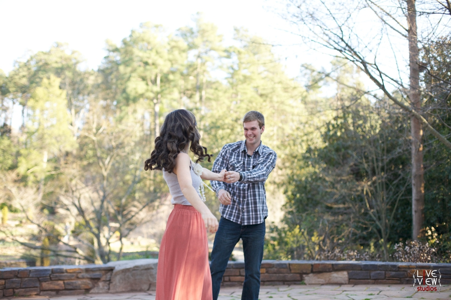 young couple dancing at duke gardens in nc, romantic couples portraits