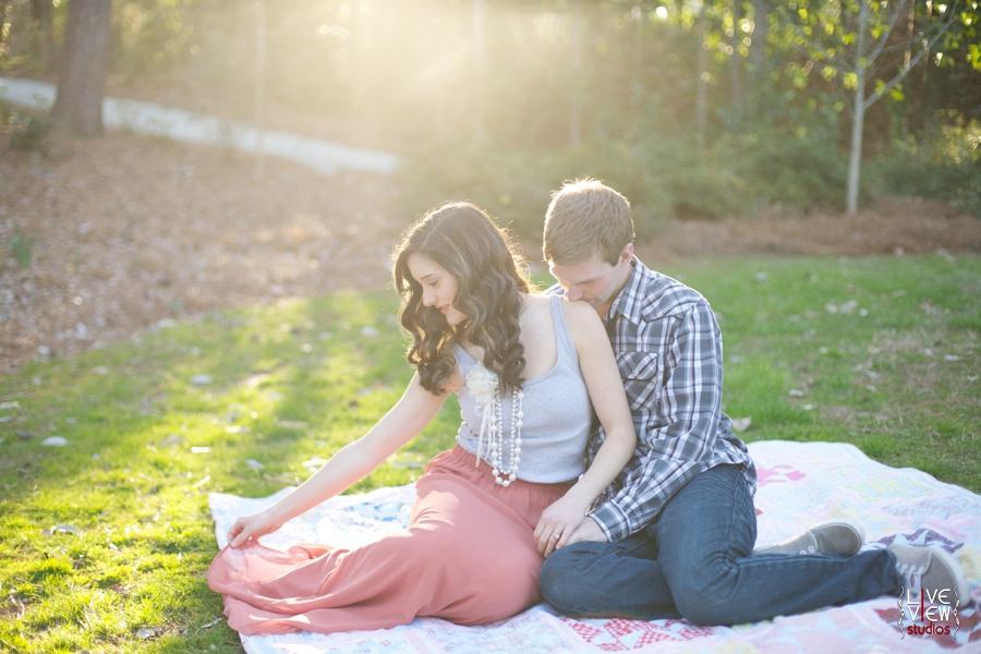 couple enjoying nature at duke gardens, romantic spring engagement photography