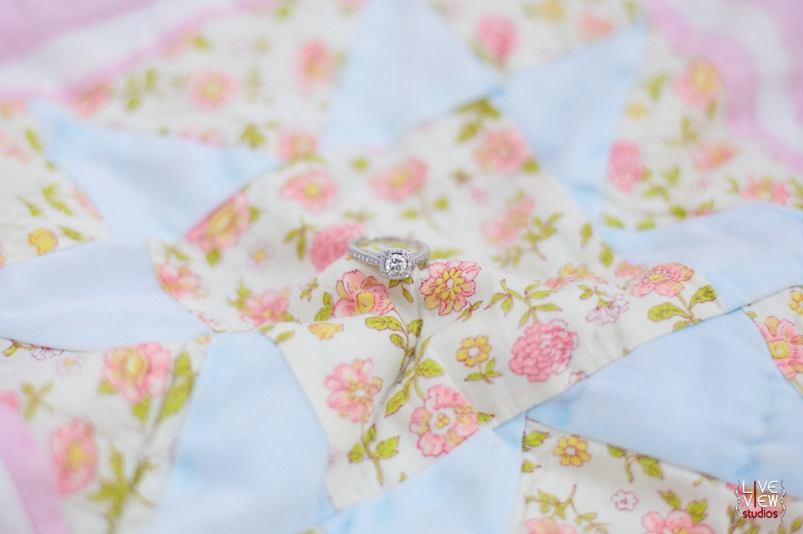cute ring shots, engagement ring on heirloom quilt