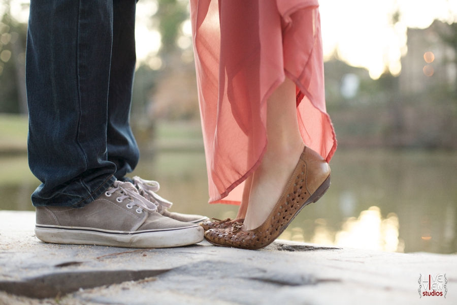 lakeside tip-toe kiss, romantic outdoor engagement photography