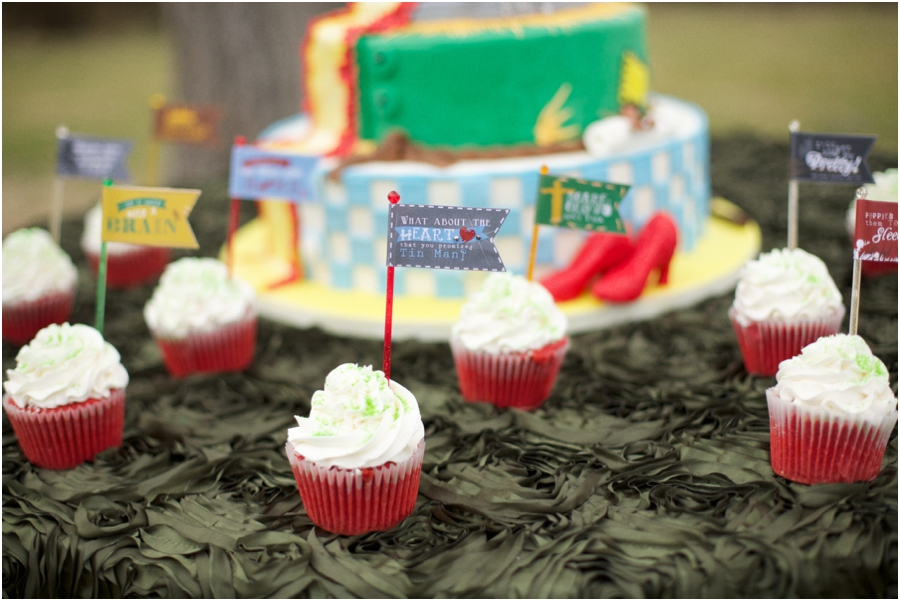 oz-inspired wedding reception ideas, red cupcakes with quotes from the wizard of oz