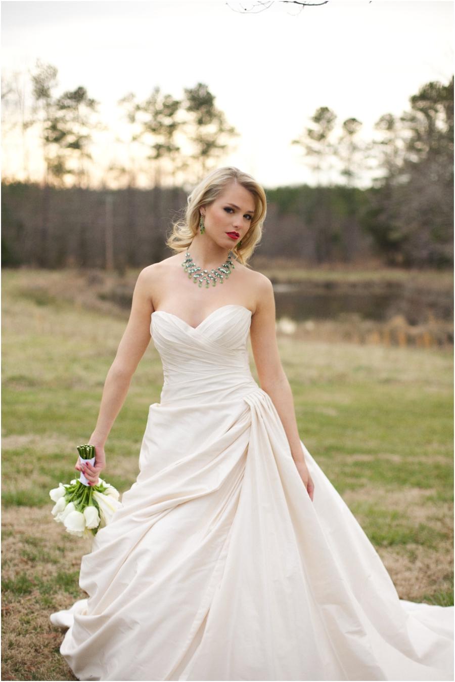 emerald wedding color schemes, bride with emerald statement necklace