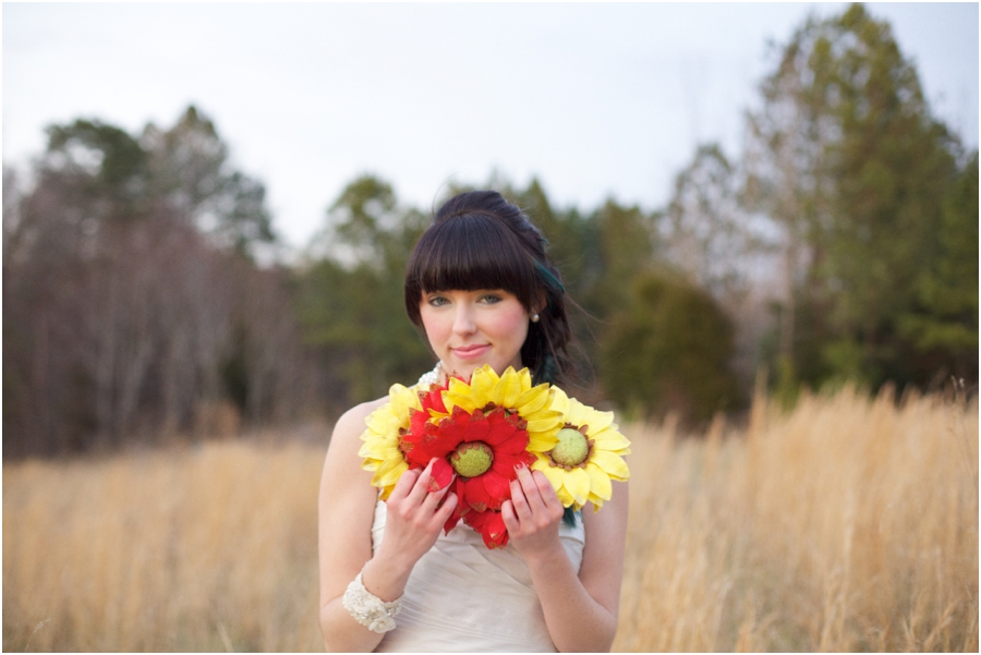 bright bridal bouquets, bride holding big bright red and yellow flowers