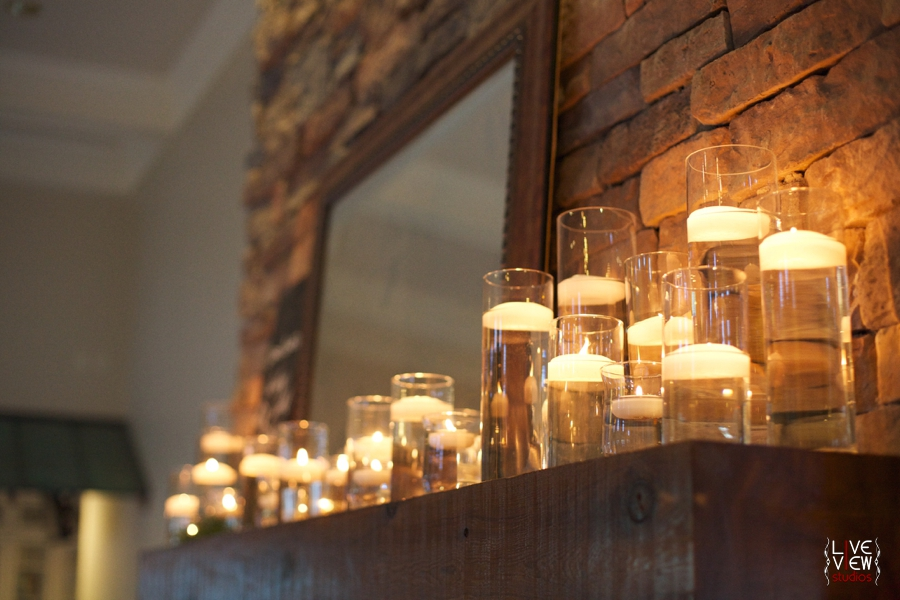 candles burning on the fireplace mantle at piazza at portofino, raleigh nc wedding photography