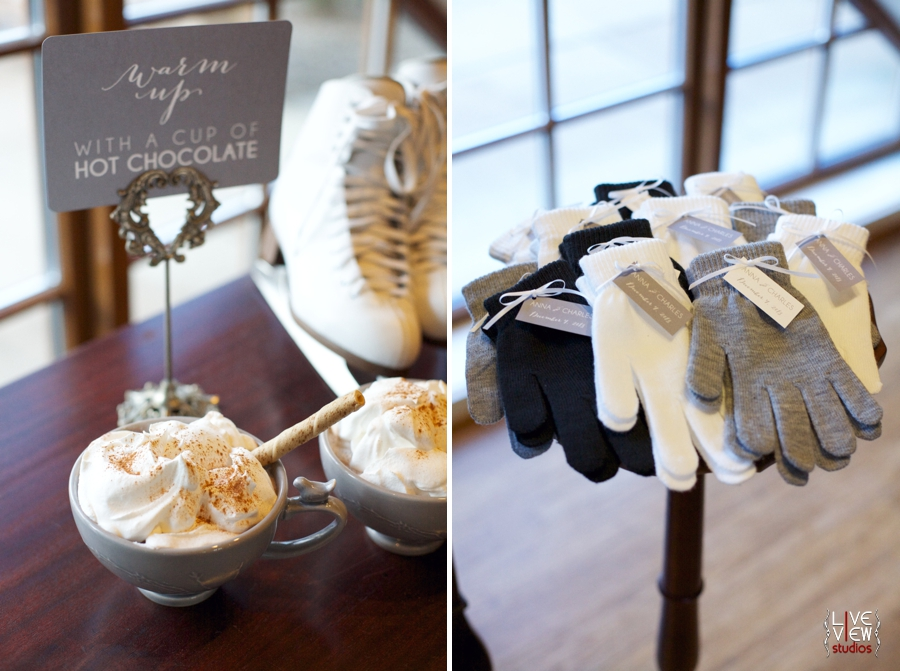 winter wedding reception inspiration, mugs of hot chocolate with whipped cream on top, pairs of cream, grey, and black gloves as wedding favors