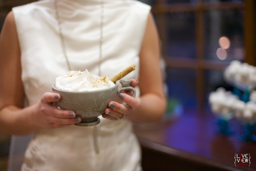 bride holding a mug of hot cocoa topped with whipped cream, winter wedding inspiration