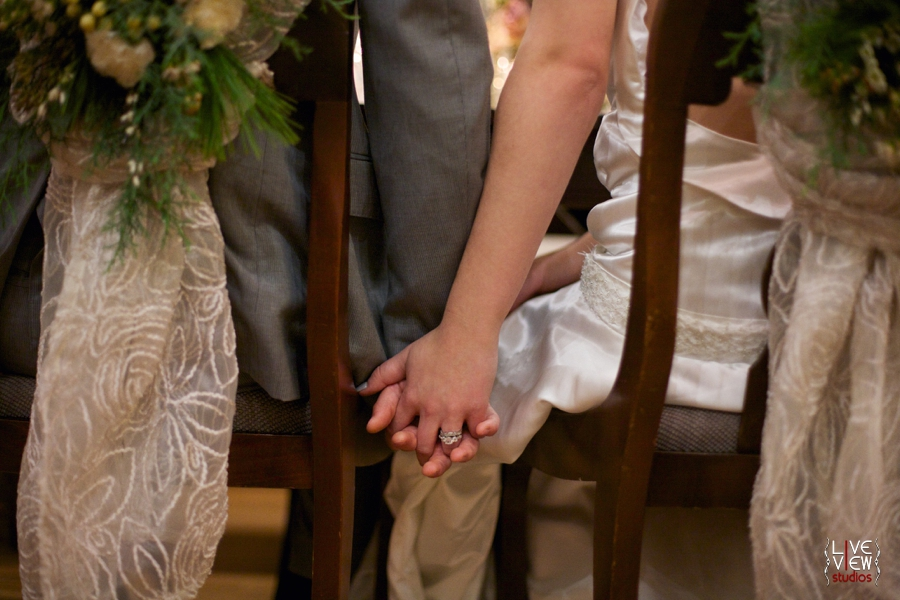 bride and groom holding hands at reception table, winter wedding inspiration, raleigh nc wedding photographers