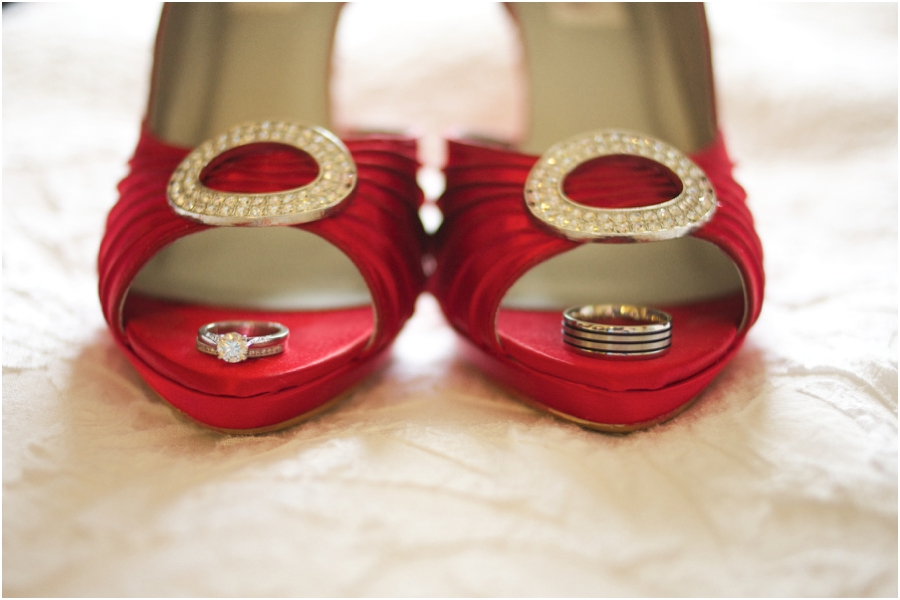 cool ring shot ideas, wedding bands on bride's cherry red high heels