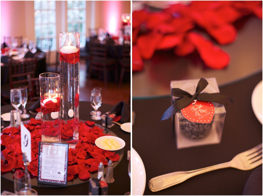 elegant table decor, candles in tall glass vases and red rose petals on black table cloths