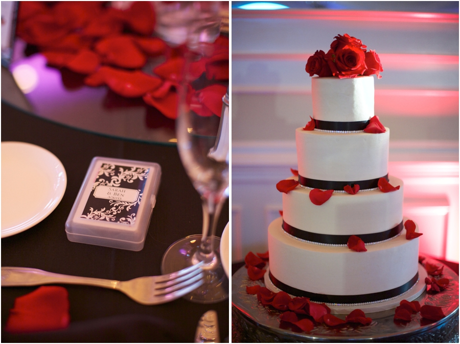 wedding favors at southern high grove wedding reception, elegant white wedding cake with black accents and red roses