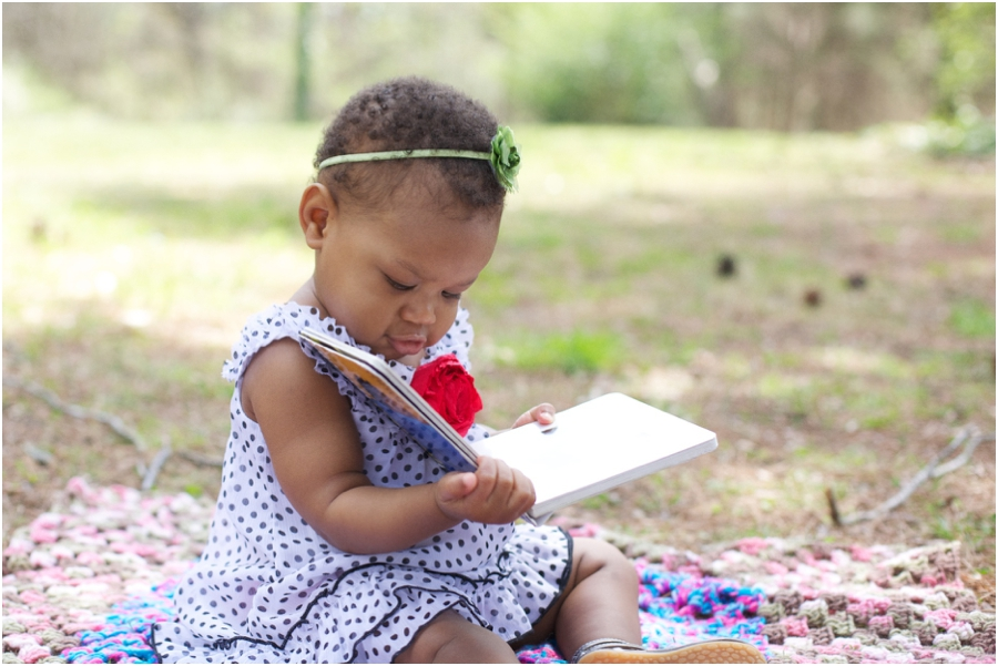 raleigh baby photography, baby girl reading a book