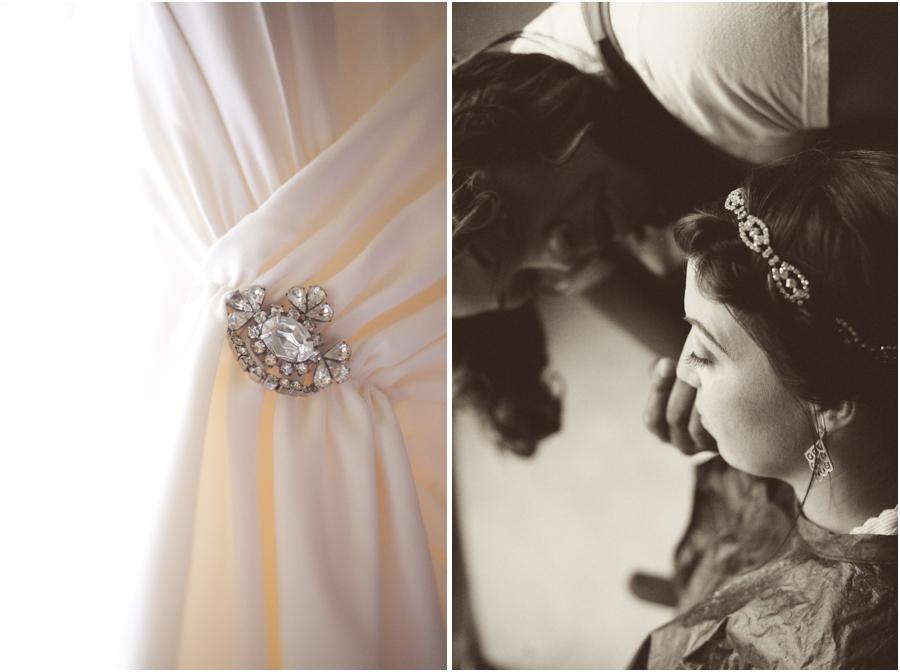 rhinestone brooch on beautiful wedding dress, bride getting her make up done