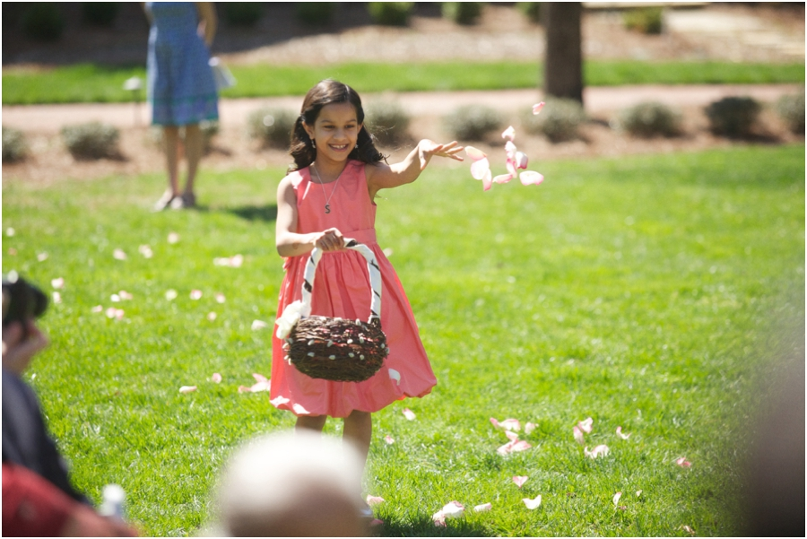 flower girl in a cute pink dress, outdoor wedding photography