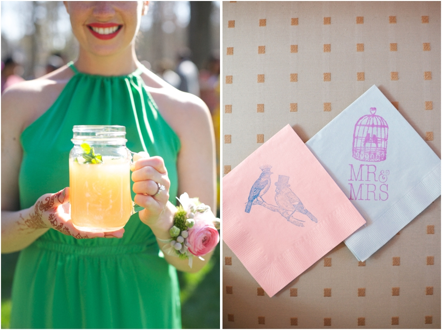 bridesmaid holding mint-topped grapefruit juice at wedding reception, stamped pink and blue napkins at reception