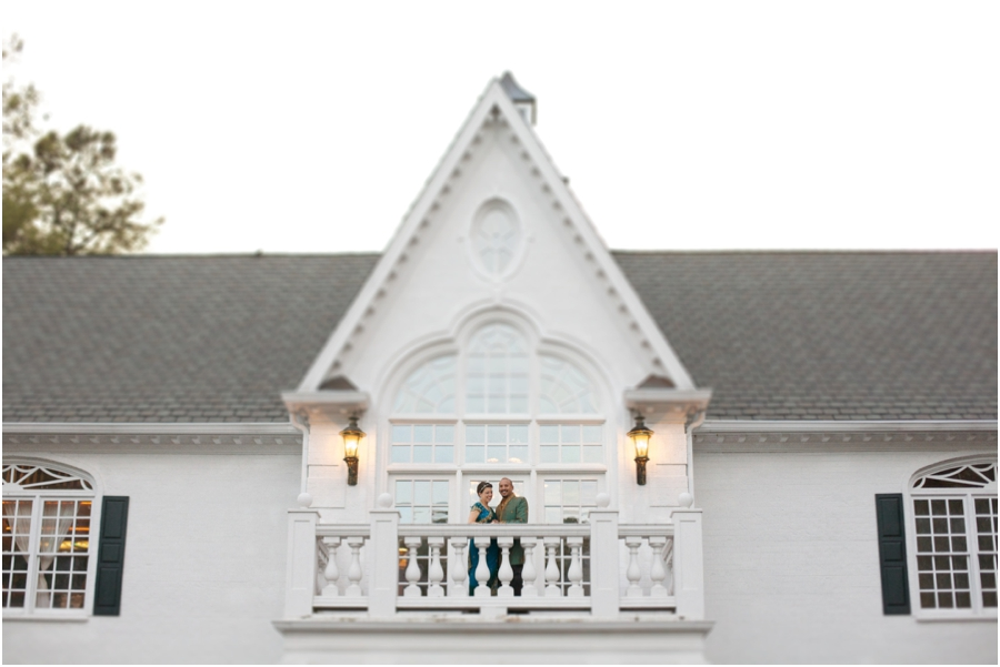 bride and groom smile at guests from a balcony , southern weddings