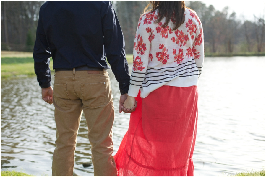 couple holding hands by the lake at cloer vineyards, southern engagement photographers, raleigh nc