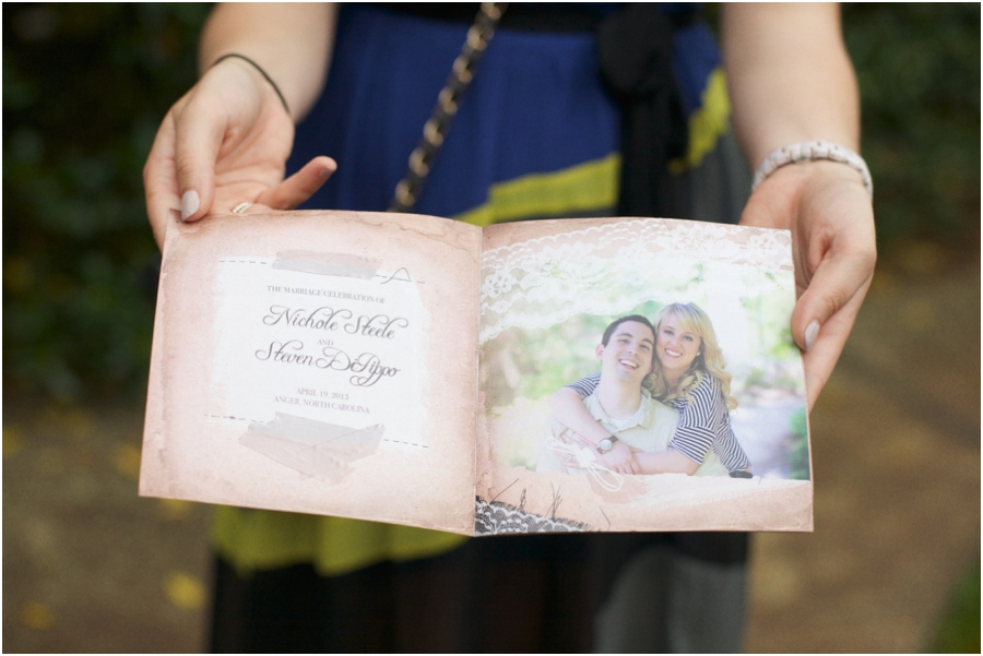 guest holding out wedding program, romantic southern wedding photographers