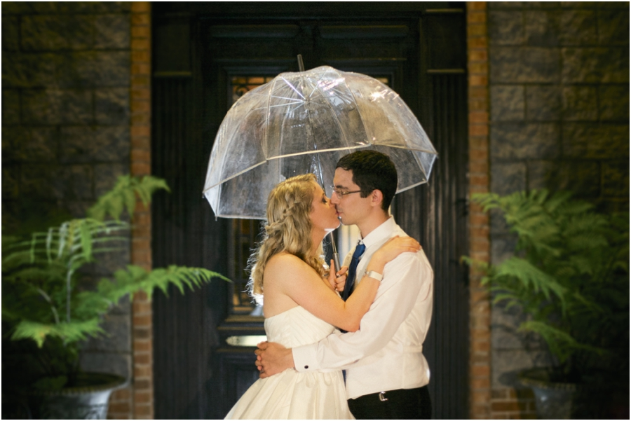 romantic southern wedding photography, bride and groom kissing in the rain