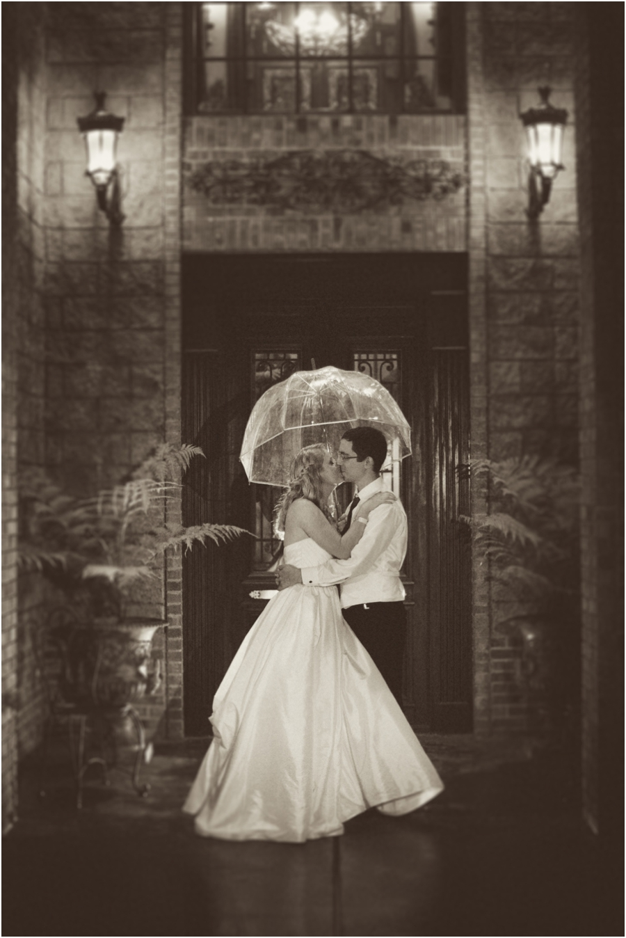 vintage wedding portraits, bride and groom kissing in the rain