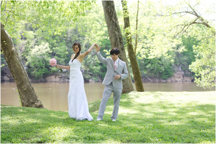 bride and groom dancing by a river, romantic first look photography