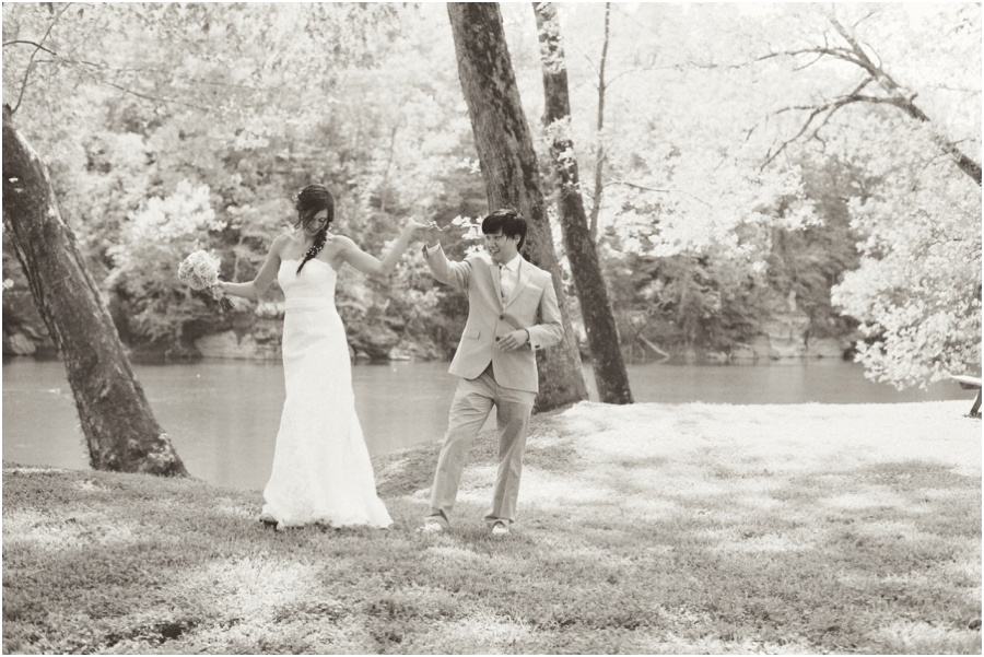 beautiful black and white wedding photography, bride and groom dancing by the riverside