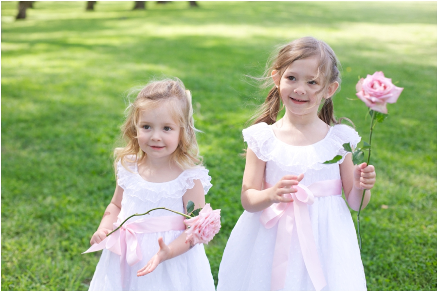 flower girls with long-stemmed light pink roses, southern wedding photography