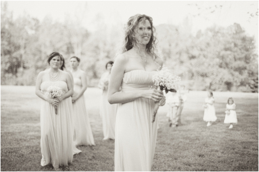 bridesmaids walking up at a beautiful outdoor wedding, vintage wedding photographers