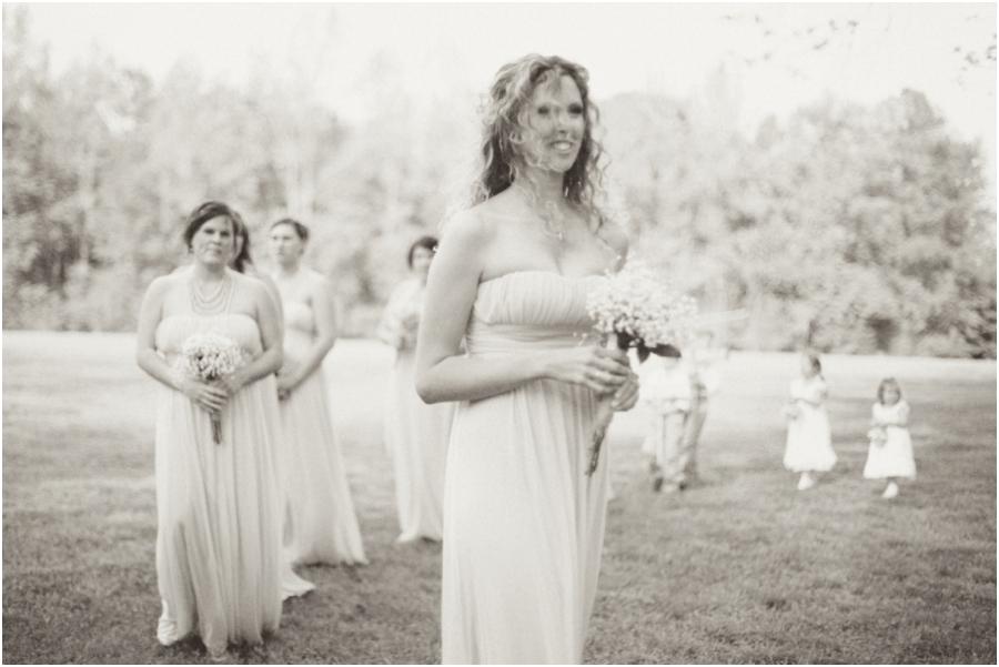 bridesmaids walking up at a beautiful outdoor wedding, vintage wedding photographers