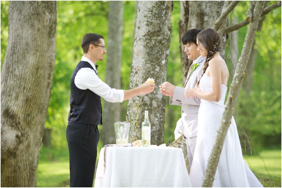 bride and groom having communion at wedding ceremony