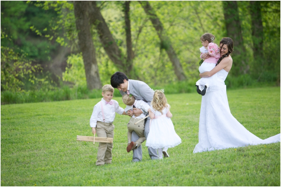 bride and groom with sign bearers and flower girls, forest wedding photography, southern wedding photographers