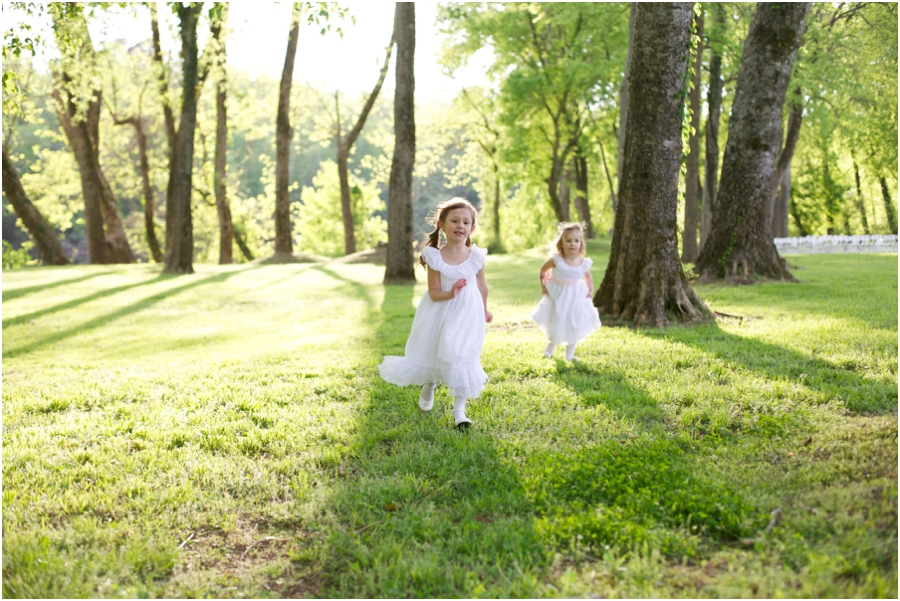 flower girls running through a field, woodsy wedding photography, southern wedding photographers