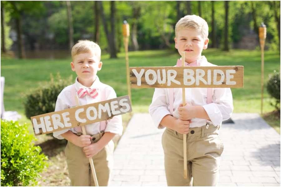 sign bearers in striped bow ties, vintage wedding photographers
