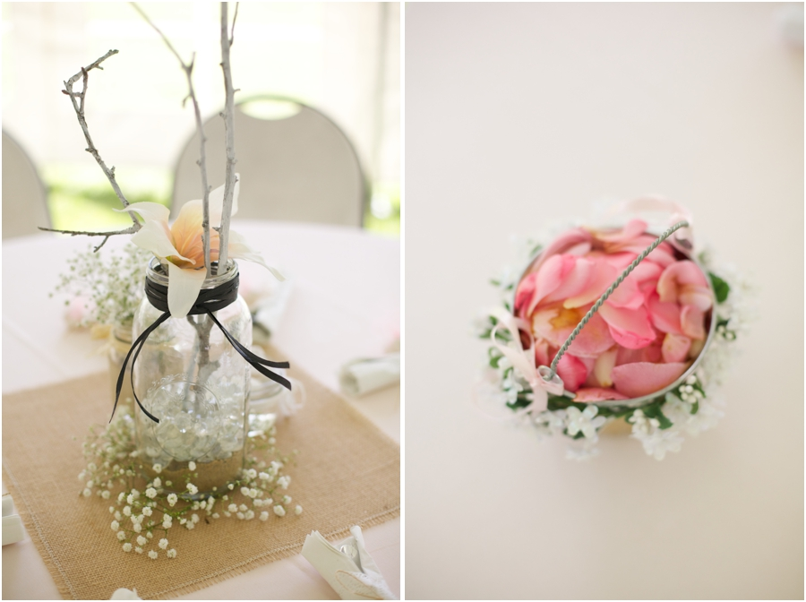 woodsy floral table centerpiece at wedding reception, flower girl's basket of pink rose petals