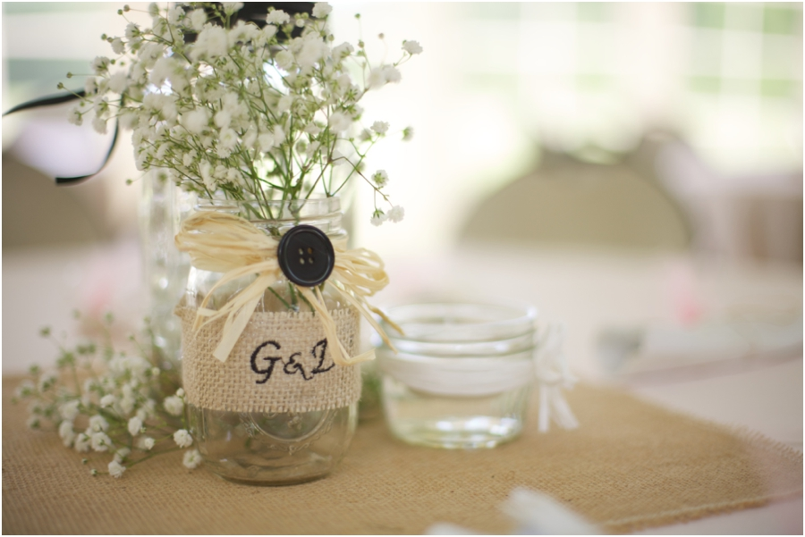 rustic wedding reception ideas, baby's breath in a mason jar wrapped in burlap