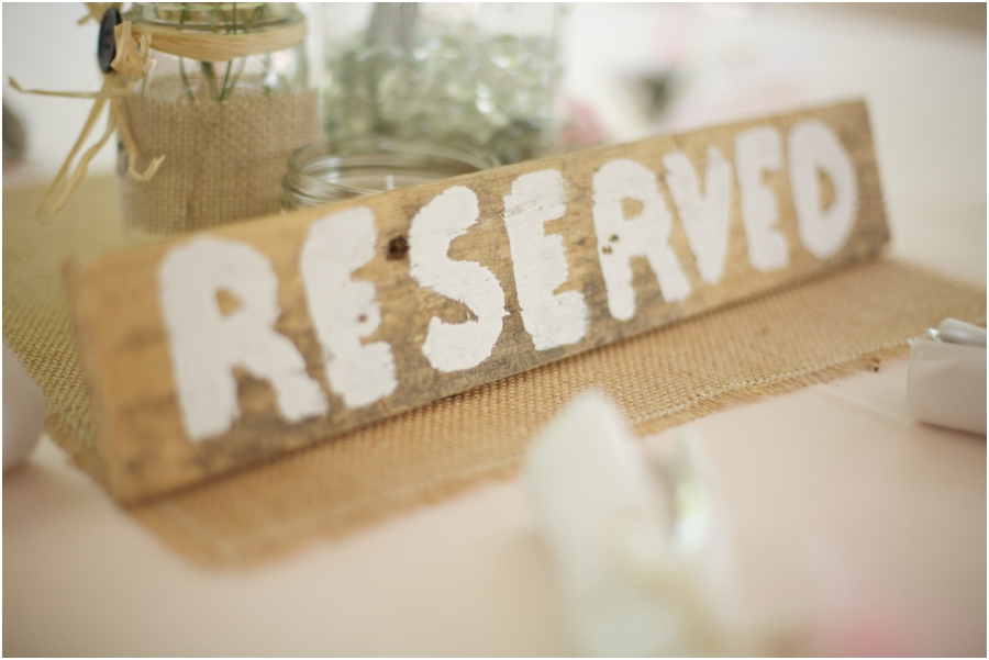 rustic reception inspiration, reserve seats with hand painted wood signs, southern wedding photography