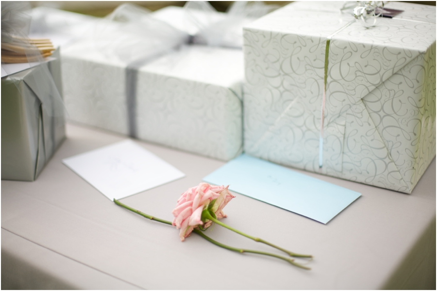 long-stemmed pink rose on gift table, southern wedding photography