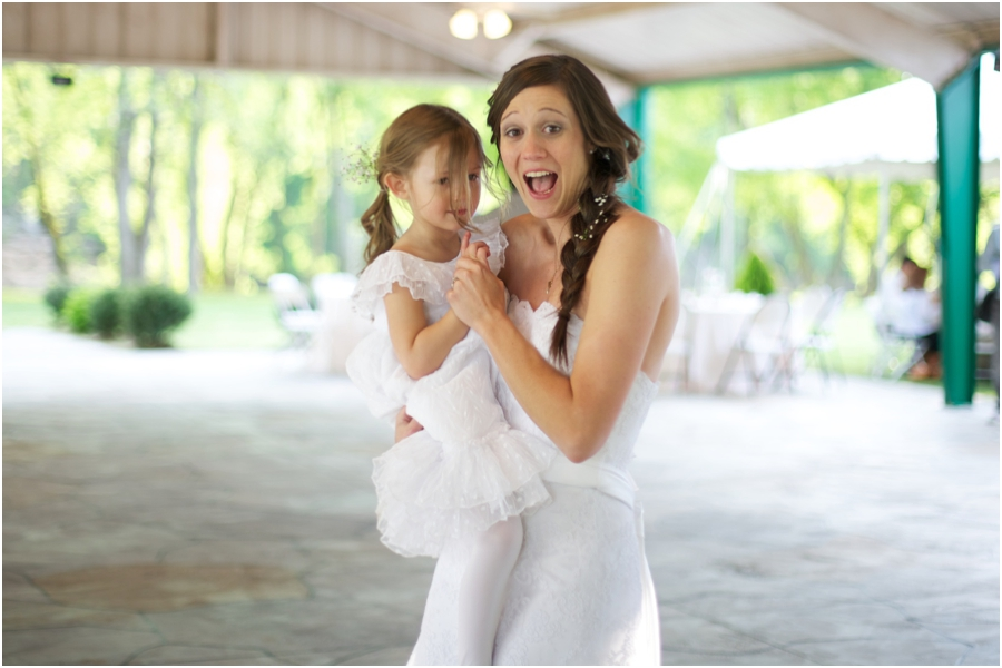 bride dancing with flowergirl, rustic spring wedding photography