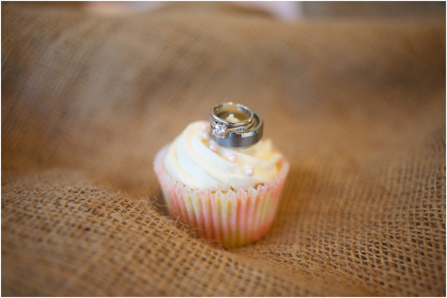 cute ring shots, wedding bands on creamy cupcake, rustic wedding photography