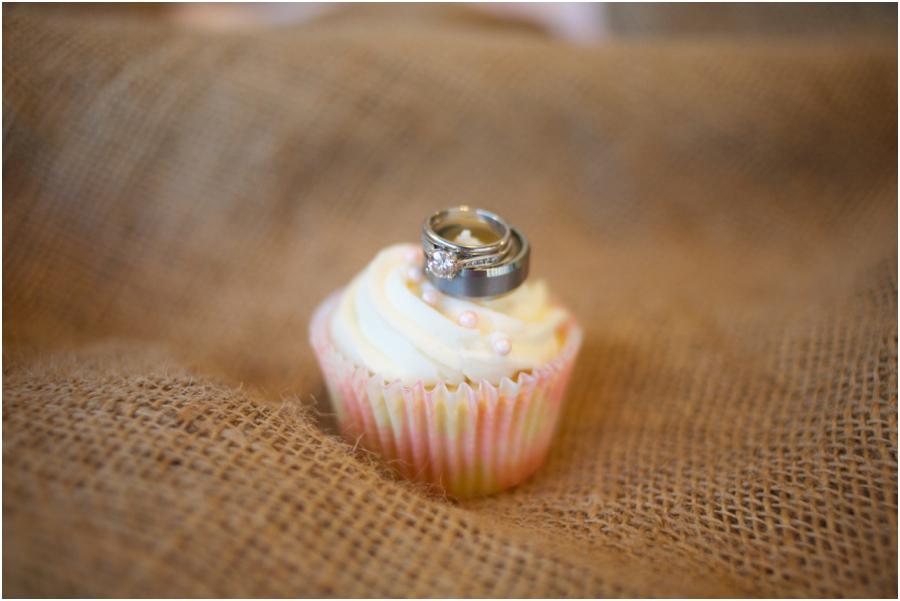 cute ring shots, wedding bands on creamy cupcake, rustic wedding photography